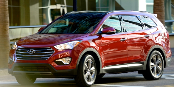 Four bars in the grille and longer windows indicate that this is the three-row version of Hyundai�s sharp-looking, strong-selling Santa Fe crossover sport-ute. Hyundai photo