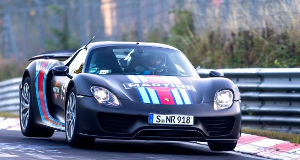 Lean, green speed machine: A Porsche 918 Spyder plug-in hybrid, all four corners off the ground, strafing the Nurburgring less than two weeks ago to smash the lap record for a street car. (Note the license plate.) Porsche photo